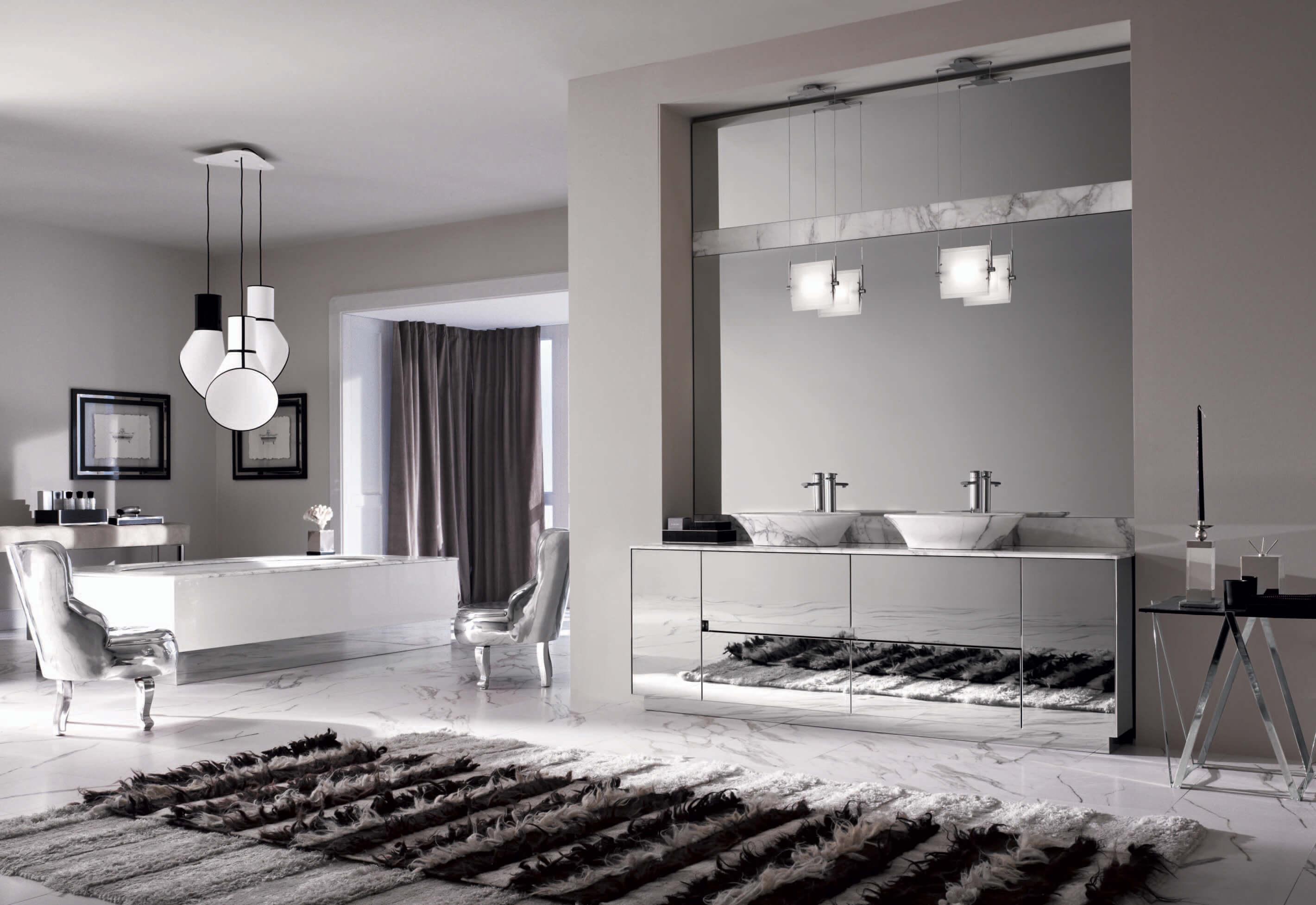 Puro by Noorth Mit einem minimalistischen und edlem Design, rasiermesserscharfen Kanten und kostbaren Oberflächen der Waschtischunterschränke begeistert das Modulsystem für das Badezimmer auf den ersten Blick. Sofort ins Auge sticht die Reduktion auf das Wesentliche: Anstatt von Türgriffen findet man versteckte Handgriffe vor, die je nach gewünschter Höhe seitlich angebracht werden. Gemeinsam mit indirekten LED-Leuchten wird dadurch der Fokus auf die pure Formenschönheit gelenkt. Herausragende Materialien, wie handverlesene Hölzer, Marmor, Granit und Keramik reduzieren das Mobiliar auf das Wesentliche und helfen dabei, über das Sein nachzudenken und sich während eines entspannten Bades in der geometrisch genauen Wanne zurückzulehnen und sich auf die wichtigen Dinge des Lebens zu besinnen.
