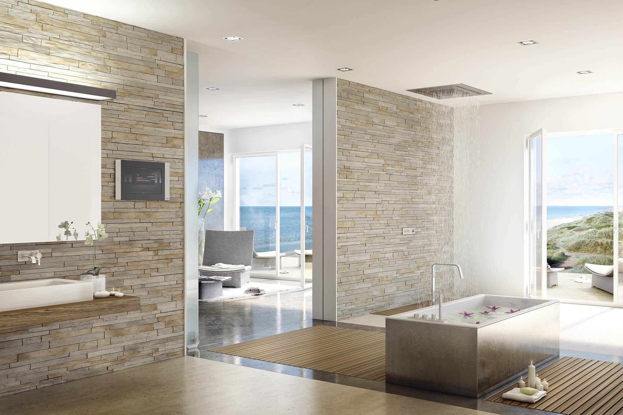 Badtrends 2019: Smart Home 2.0 Der Trend für das Badezimmer 2019 im elektrischen Bereich, ist die zunehmende Gewinnung von Land durch intelligente Steuerungssysteme. Diese erfassen nicht nur die Unterhaltungselektronik, die auch im Badezimmer Einzug gehalten hat, sondern auch Temperaturregler, Rollläden, Lüftungen, Wassertemperatur und vieles mehr. Auf Wunsch werden bereits heute futuristische Spiegel angefertigt, die nicht nur Zeit- und Temperaturanzeigen in die glatte Oberfläche integriert haben, sondern auch einen Touchscreen, mit dem man beispielsweise eine bestimmte Playlist per Handbewegung auswählen kann. Auch das Einlassen einer Badewanne funktioniert mittels des Smartphones, das an das hauseigene Steuerungssystem gekoppelt ist und damit auch von unterwegs aus erledigt werden kann. Und seien wir doch einmal ehrlich – Wer möchte nicht nachhause kommen und gleich in die fertig gefüllte Badewanne springen, die von einem herrlichen Duft aus dem ebenfalls intelligent steuerbaren Spender eingehüllt wird.